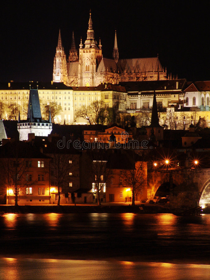 Colorful Prague Gothic Castle In The Night On Vltava