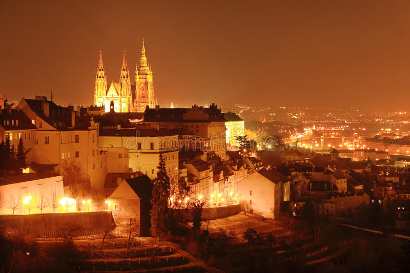 Colorful Prague with gothic Castle in the Night royalty free stock image