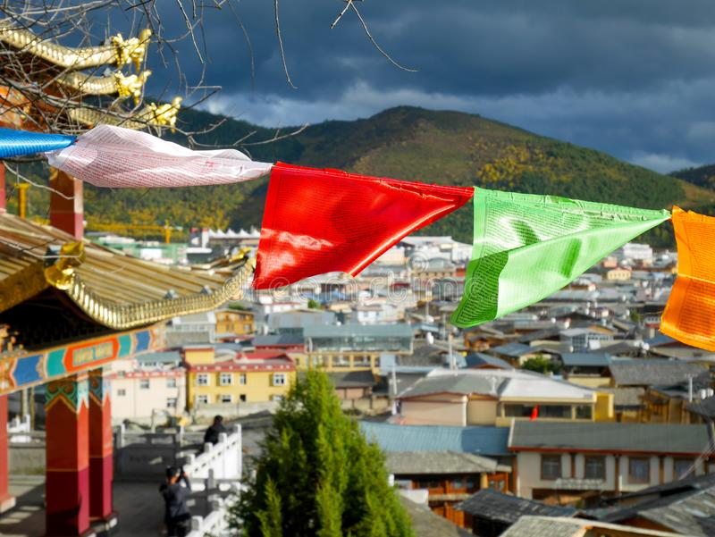 Colorful prayer flags in Guishan temple. In the old town of Shangri-La, Yunnan, China stock image