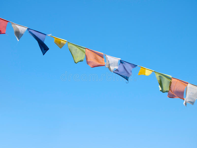 Colorful prayer flags over a clear blue sky in India stock photo
