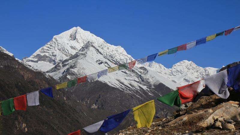 Colorful prayer flags and snow capped mountains. Scene near Namche Bazar royalty free stock photos
