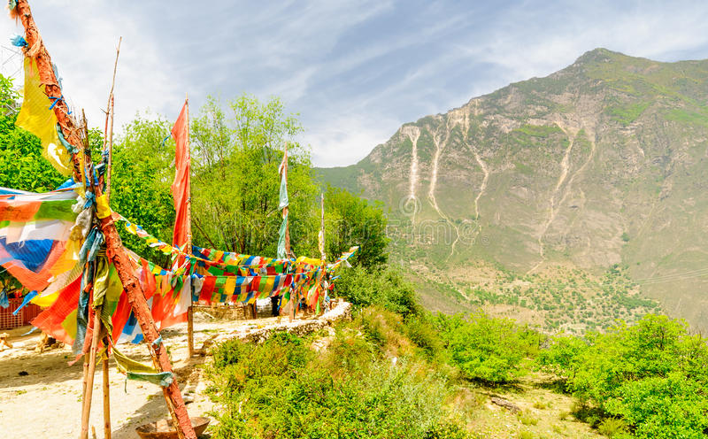 Colorful prayer Flags in Tibetand mountains royalty free stock image