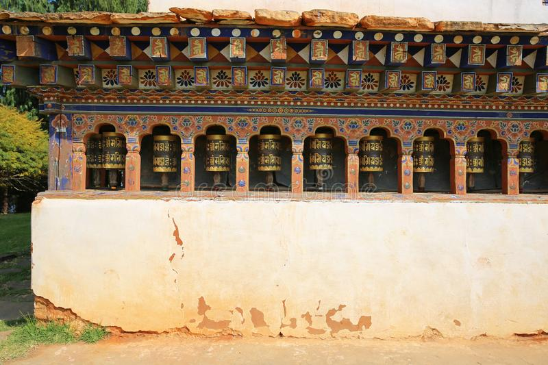 Colorful Prayer Wheels in Ancient Buddhist Temple, Bhutan stock photos