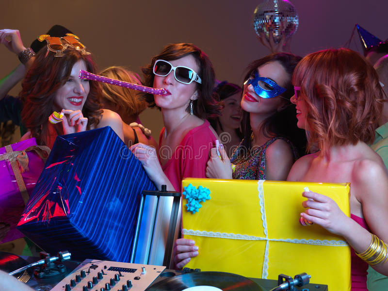 Colorful presents and beautiful girls playing royalty free stock image