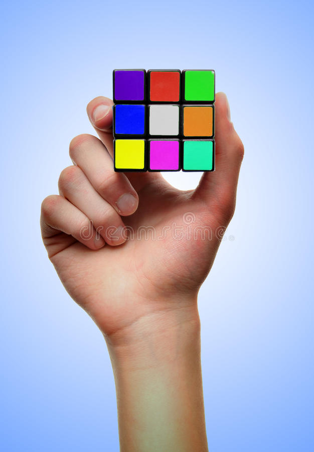 Colorful Problem solving puzzle cube. White male Caucasian hands problem solve with a puzzle cube You must contact Seven Towns Ltd for permission prior to any royalty free stock photos