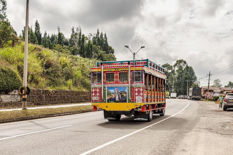 Colorful public bus on the road in Guatape, Colombia. Guatape, Colombia – March 27, 2018: Colorful old public bus on the road in Guatape, Colombia royalty free stock image