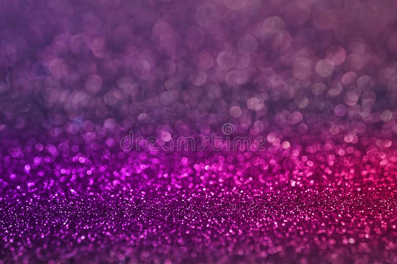 Colorful purple pink bokeh light glitter background for Christmas and New Year`s day stock images