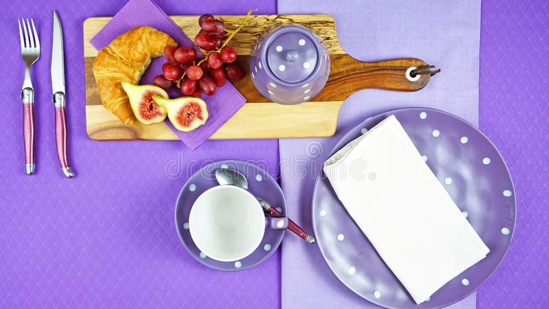Colorful purple theme breakfast brunch table setting flatlay with copy space. Modern bright colorful purple theme morning breakfast or brunch table setting royalty free stock photos