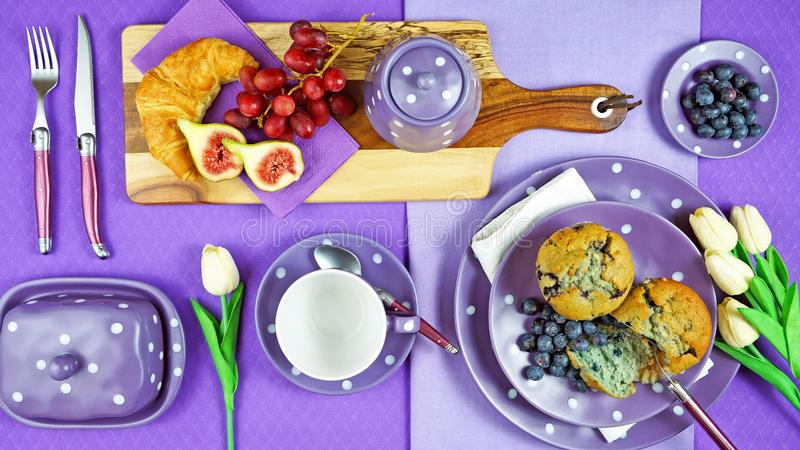 Colorful purple theme breakfast brunch table setting flatlay. Modern bright colorful purple theme morning breakfast or brunch table setting, flat lay royalty free stock images