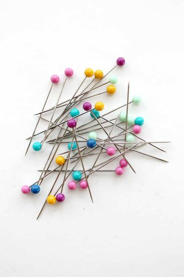 Colorful push pins for sewing on a white background stock photography