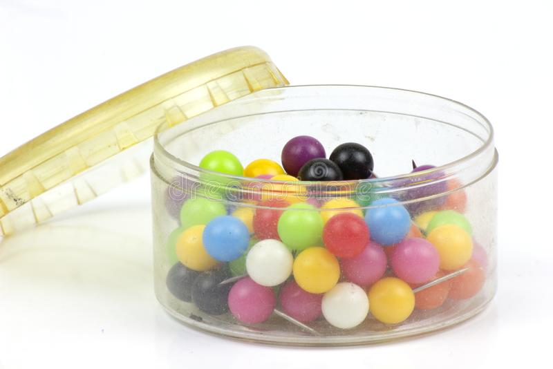 Colorful push pins on white background royalty free stock photography