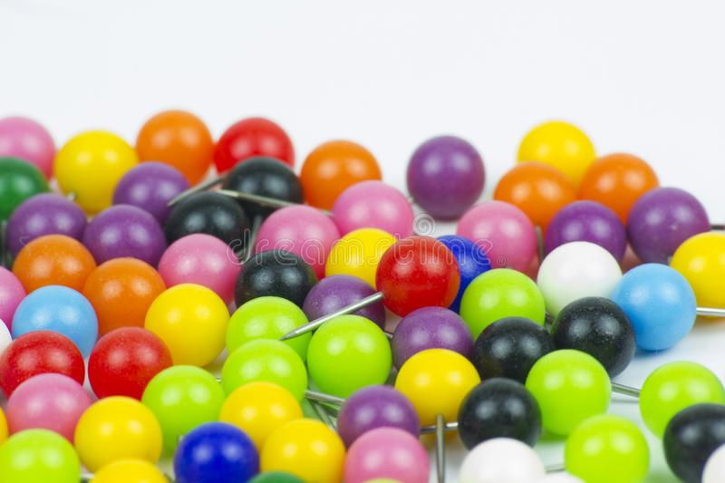 Colorful push pins on white background stock photos