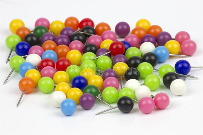 Colorful push pins on white background royalty free stock photos