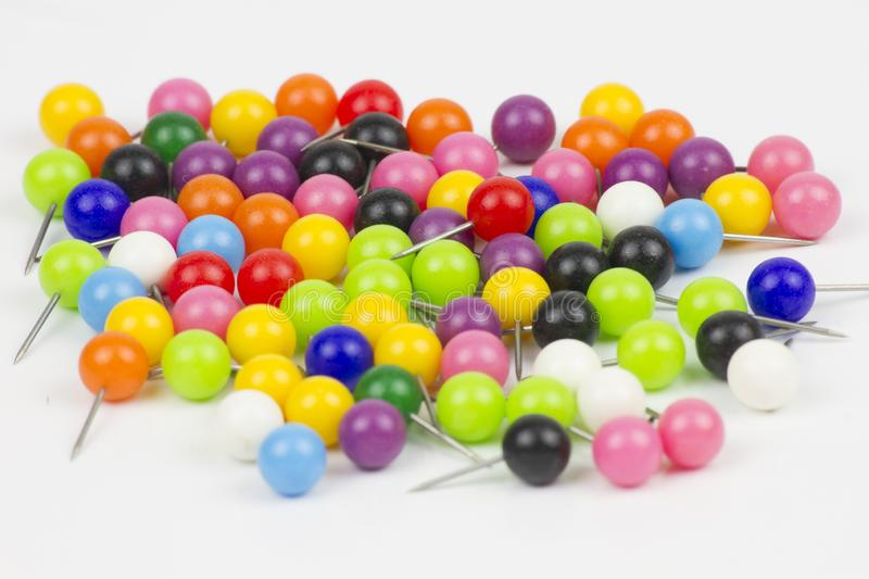 Colorful push pins on white background royalty free stock photo