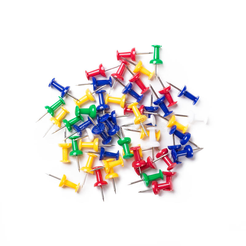 Colorful push pins on white background stock images