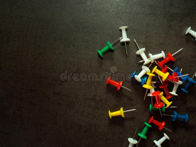 Colorful pushpins royalty free stock photography