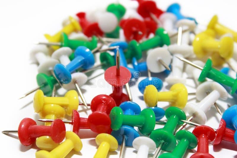 Colorful pushpins on white background stock photo
