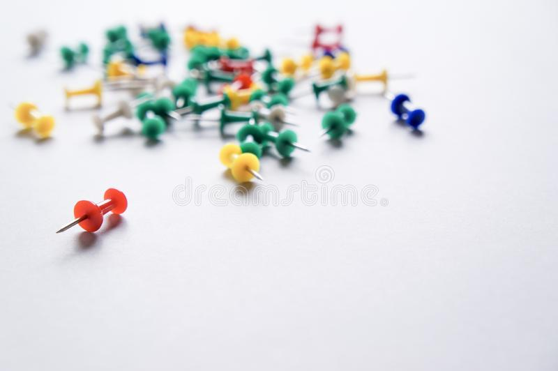Colorful pushpins on a white background stock photos