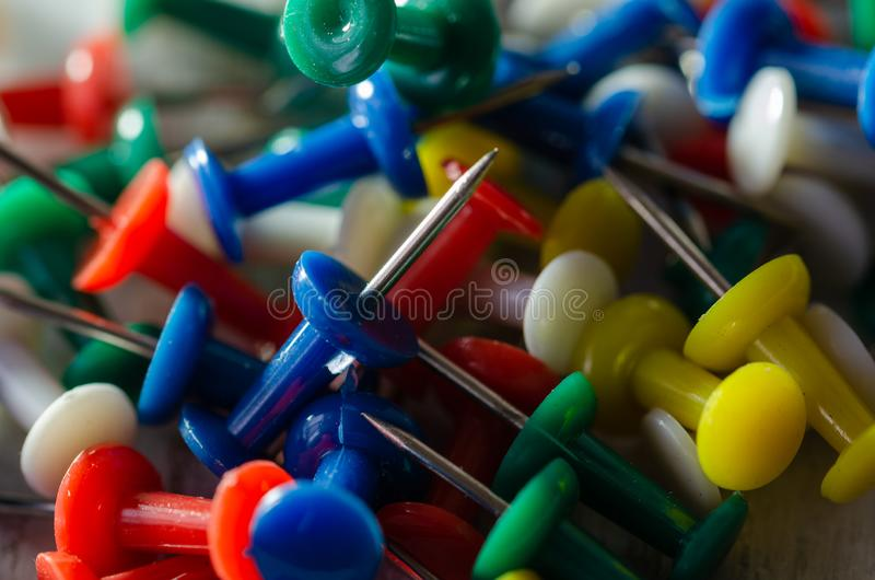 Colorful pushpins on the table. stock photography
