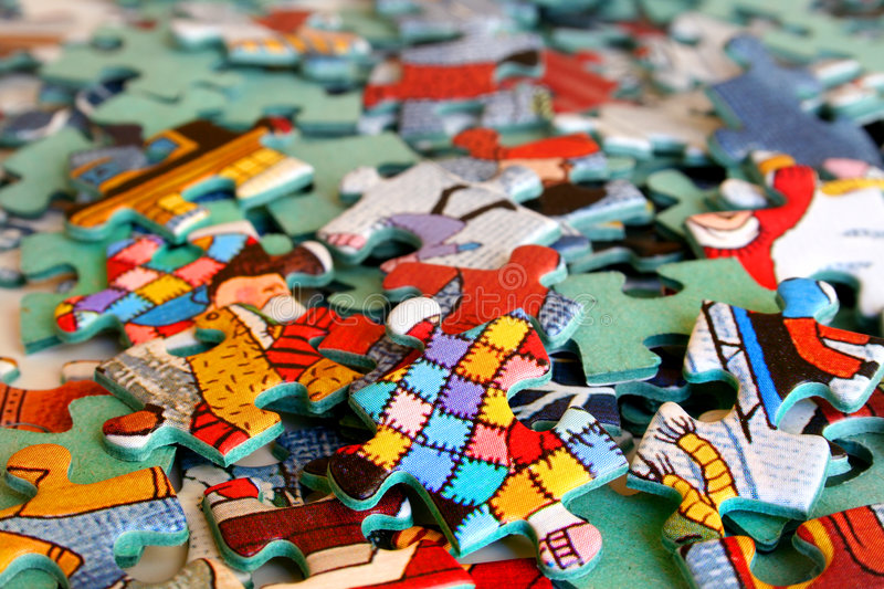 Colorful puzzle pieces. A bunch of colorful puzzle pieces stock image