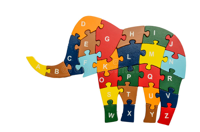 Colorful puzzle pieces isolated over white. Colorful puzzle pieces in elephant shape isolated over white royalty free stock photo