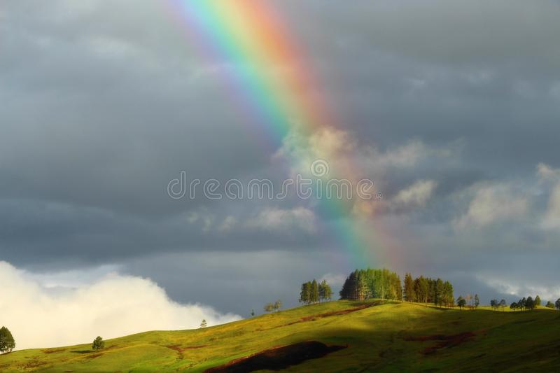 Papua New Guinea Rainbow over Mountain stock images