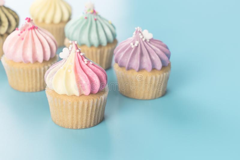 Colorful rainbow cupcake set on blue pastel toning stock image