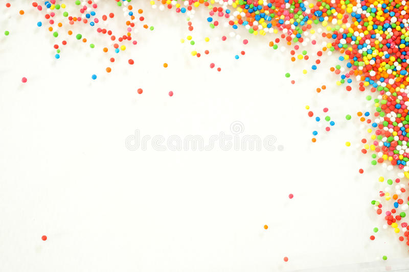 Colorful rainbow sprinkles backgroung stock photo