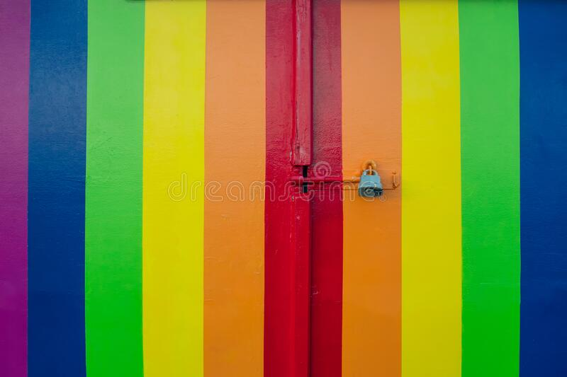 Colorful rainbow stripy door in LGBT flag colors with a padlock. Love Diversity under a ban, prohibited. Depicting the lack of. Right of same-sex marriage of stock images