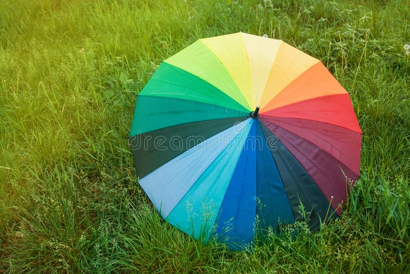 Colorful Rainbow Umbrella over a Green Grass Field Sunrisez Copy Space Spring Summer Rain stock photos