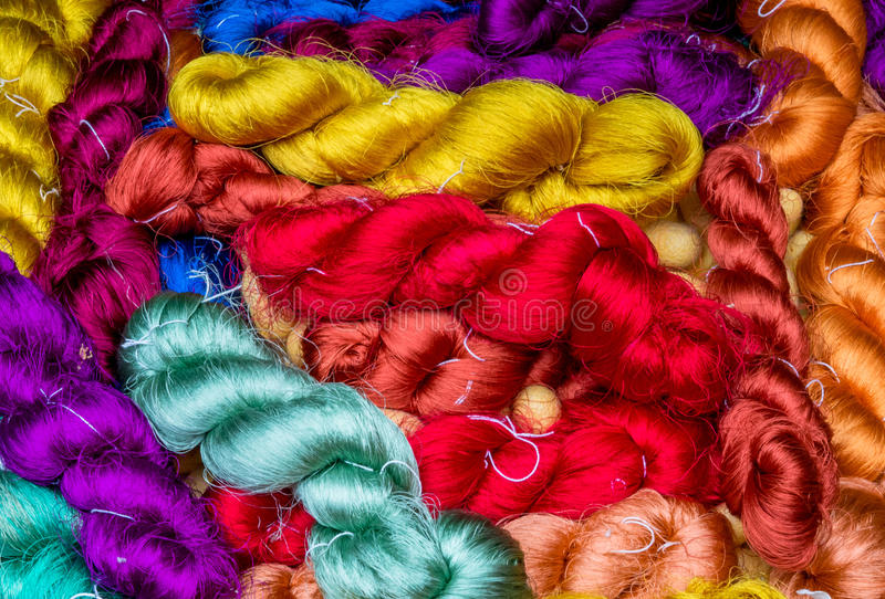 Colorful raw silk thread background stock image