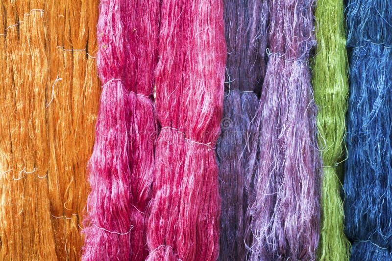 Colorful raw silk thread in silk farm stock photos