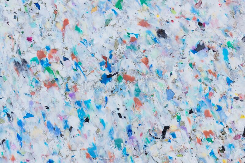 Colorful Recycling Plastic Board: Surface Texture. Detail of different coloured plastic pellets conglomerated to a recycling plastic board stock photos