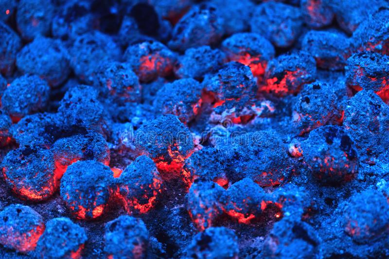 Colorful red and blue burning charcoal as best background for bb stock photography