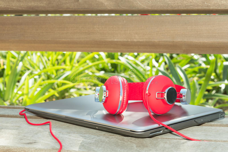 Colorful red headphones and notebook royalty free stock photos