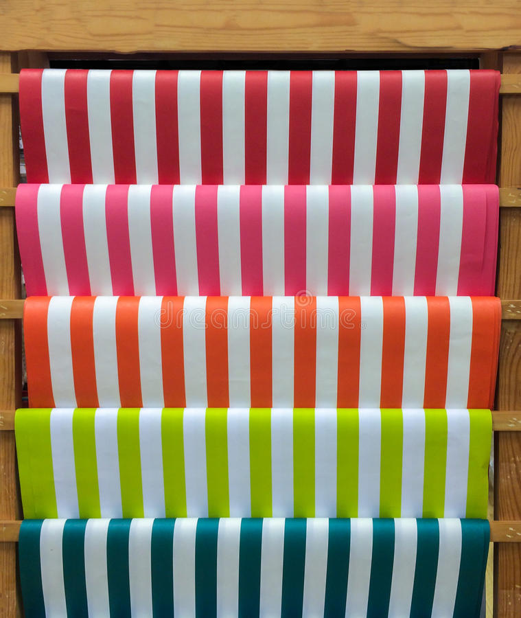 Colorful Red, Pink, Orange, Green and Blue Stripe Pattern Paper on Wooden Shelf for DIY Work. And Design stock photos