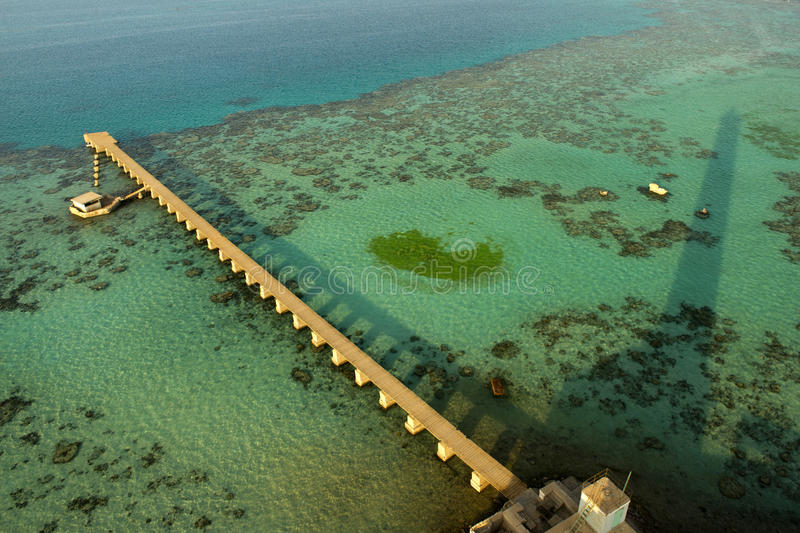 Colorful red sea reef and wharf aerial view. Sanganeb lighthouse in red sea Sudan royalty free stock image