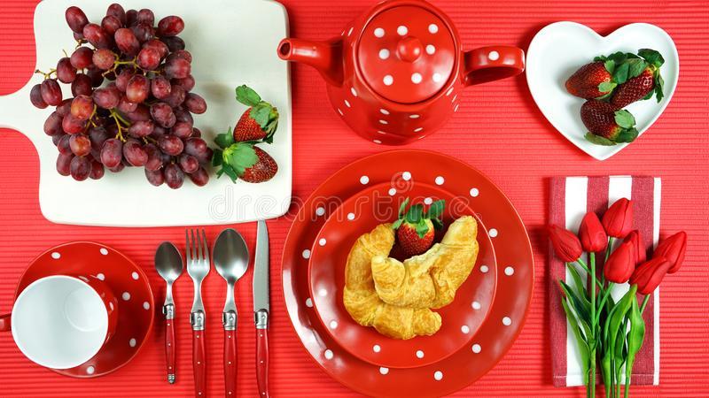 Colorful red theme breakfast brunch table setting flatlay. Modern bright colorful red theme morning breakfast or brunch table setting, flat lay royalty free stock photos