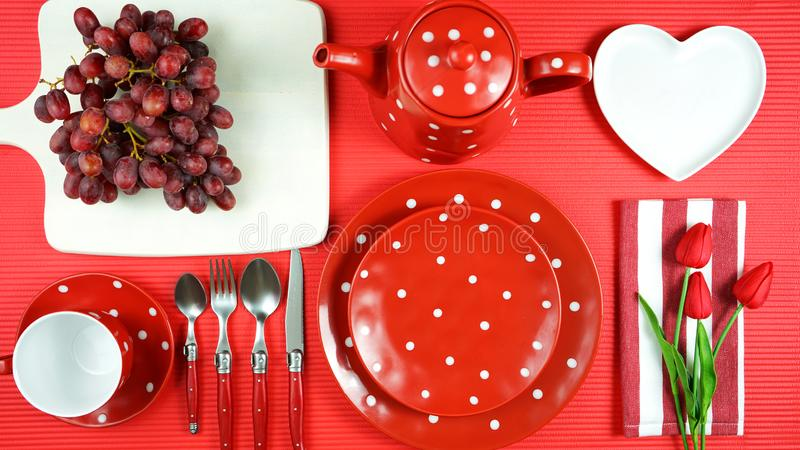 Colorful red theme breakfast brunch table setting flatlay. Modern bright colorful red theme morning breakfast or brunch table setting, flat lay stock photo
