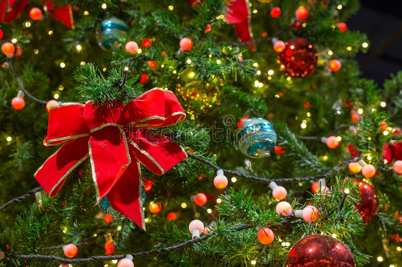 Colorful Red, Yellow and Green Christmas Tree Bokeh background of de focused glittering lights royalty free stock photos