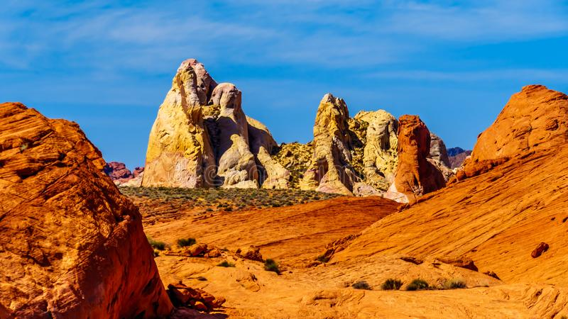 The colorful red, yellow and white sandstone rock formations at the White Dome Trail Head in the Valley of Fire State Park. In Nevada, USA stock image