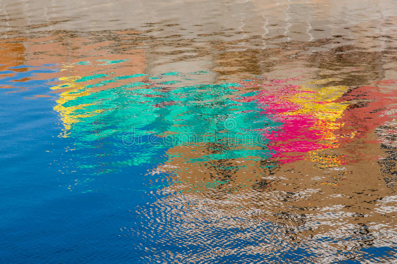 Colorful reflections in calm water royalty free stock photo
