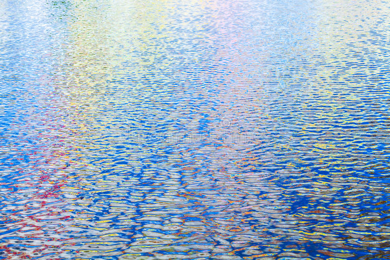 Colorful reflections pattern over ripple water royalty free stock photography