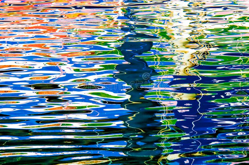 Colorful reflections on sea water - beautiful water background, Norway, Norwegian Sea, rave of colors stock photos