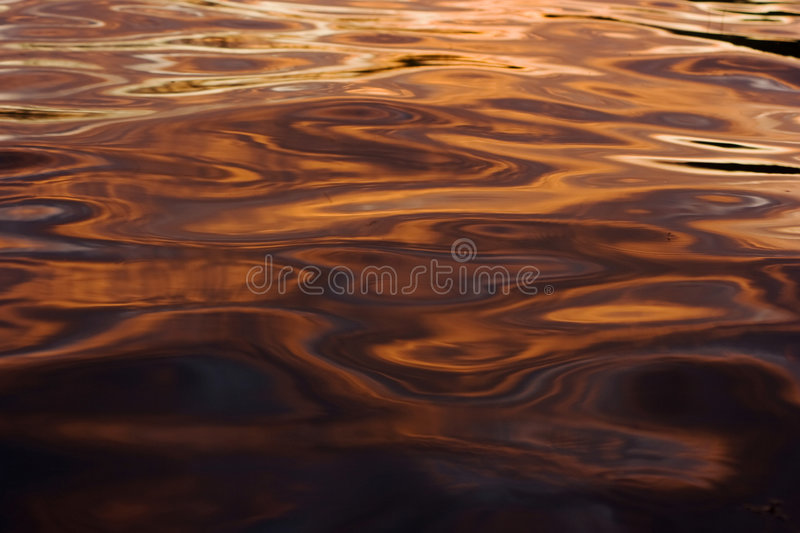 Colorful reflections on a water surface stock photos