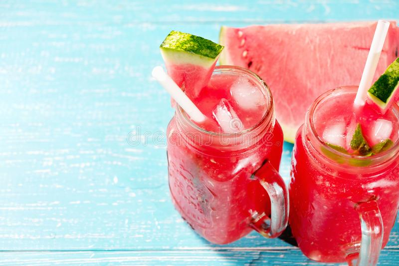 Colorful refreshing drinks for summer, cold watermelon lemonade juice smoothies in the glasses royalty free stock photography