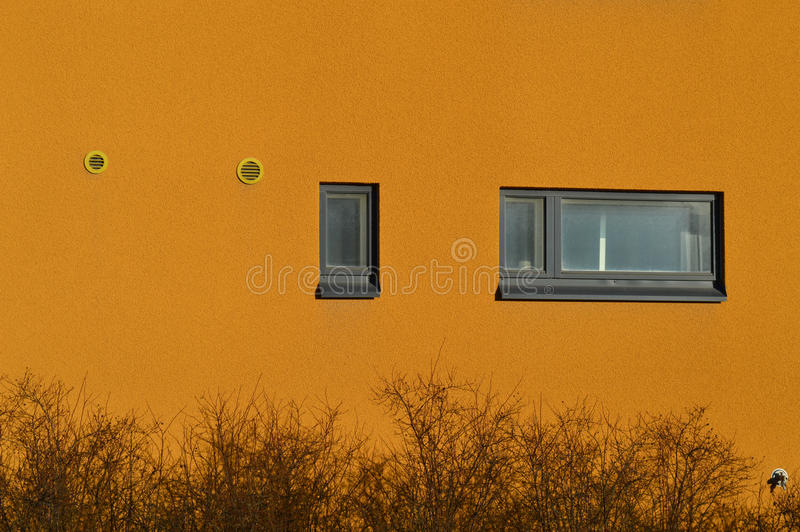 Small Round Windows: Colorful Residential Building With Windows And Air Vents