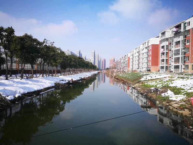 The colorful residents apartment standing river. In a sunny day royalty free stock image