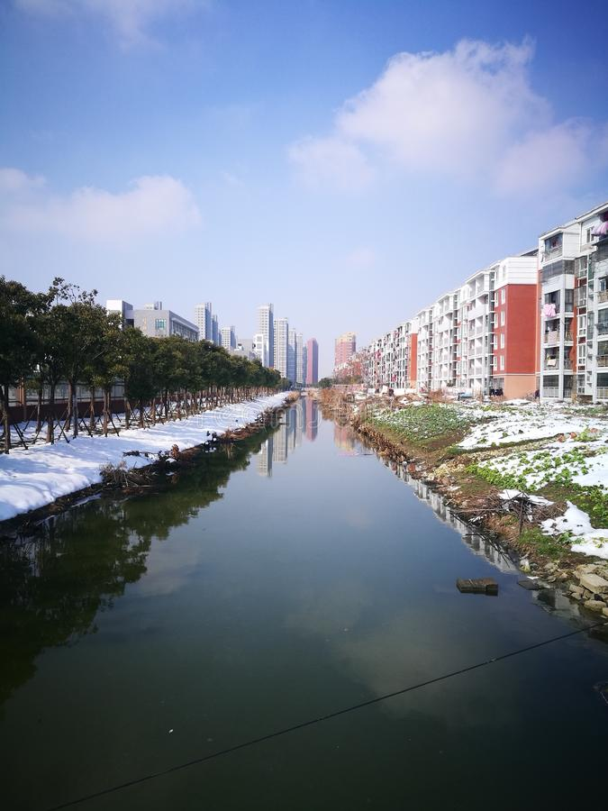 The colorful residents apartment standing river. In a sunny day stock photo