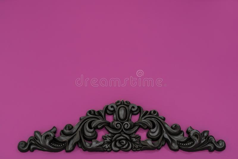 Vintage royal silver horizontal background with black ornaments on a pink wall. stock images